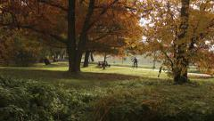 One man ride the bike in the autumn day 4416.mp4 Stock Footage