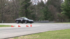 Stock Video Footage of Racing cars speeding down a track (2 of 8)
