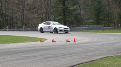 Stock Video Footage of Racing cars speeding down a track (3 of 8)