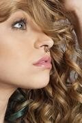 Close-up of beautiful blond woman with pierced nose looking away Stock Photos