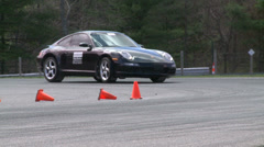 Stock Video Footage of Racing cars speeding down a track (7 of 8)