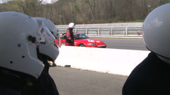 Stock Video Footage of Racing cars speeding down a track (8 of 8)