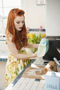 Young redheaded woman in preparation for baking Stock Photos