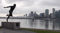 Float Plane, Cyclist and Statue in Stanley Park - stock footage
