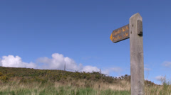 Footpath and wooden sign on exmoor Stock Footage
