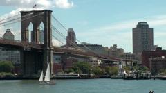 New York 358 Brooklyn Bridge & cityscape ; sailing boat Stock Footage