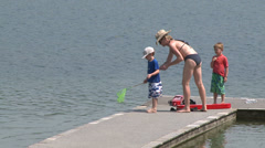 Relaxing on the beach boardwalk (3 of 9) - stock footage
