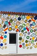 traditional portuguese pottery plates on a wall in algarve - stock photo