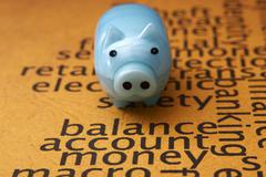 Piggy bank on balance account money Stock Photos