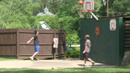 Stock Video Footage of Kids playing some backyard basketball (2 of 4)