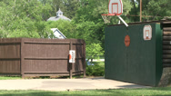 Stock Video Footage of Kids playing some backyard basketball (4 of 4)