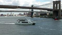 New York 359 Manhattan, East River Ferry under Brooklyn Bridge Stock Footage