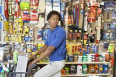 Side view of African American in hardware store Stock Photos