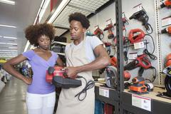 African American woman buying tool at hardware store Stock Photos