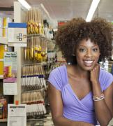 African American woman in hardware store Stock Photos