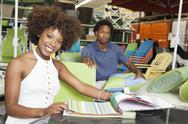 Stock Photo of Young African American couple buying Outdoor furniture at Store