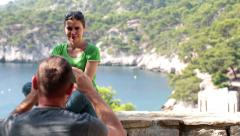 Couple on trip taking photo with cellphone in beautiful scenery HD Stock Footage