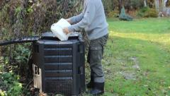 Compost - man throws kitchen scraps into a composter. 2 Stock Footage