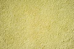 wall of concrete with yellow coating - stock photo