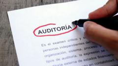 Circling Audit with a pen (In Spanish) Stock Footage