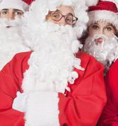 Stock Photo of Portrait of people in Santa costume