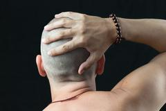 buddhist feels shaved head - stock photo