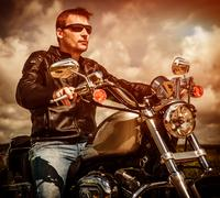 Biker on a motorcycle Stock Photos
