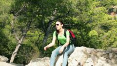 Tired woman resting during hiking trip HD Stock Footage