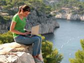 Stock Video Footage of Woman with laptop sitting in beautiful nature scenery NTSC