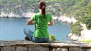 Stock Video Footage of Young woman meditating in beautiful nature scenery HD