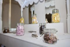 Close-up view of confectionary in glass jars - stock photo