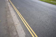Stock Photo of Double yellow line on London street