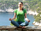 Stock Video Footage of Young woman meditating in beautiful nature scenery NTSC