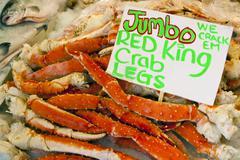 Crab Legs at fish market - stock photo