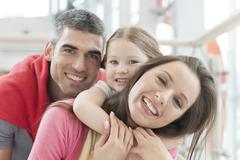Young happy family in shopping mall Stock Photos