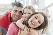 Stock Photo of Young happy family in shopping mall