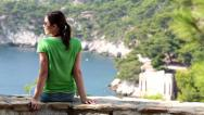 Stock Video Footage of Young woman relaxing in beautiful nature scenery HD