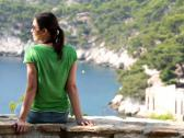 Stock Video Footage of Young woman relaxing in beautiful nature scenery NTSC