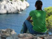 Stock Video Footage of Woman sitting, relaxing in beautiful nature scenery  NTSC
