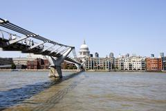 Stock Photo of View of Millennium Bridge with view of City of London in the Background