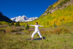 Yoga at Maroon Bells in Fall - stock photo