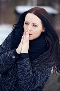 Woman shivering in the frozen outdoors Stock Photos