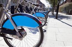 Public Rental Bicycles in a Line, London, UK - stock photo