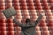 Stock Illustration of Back view of victorious businessman with briefcase facing rows of red seats at