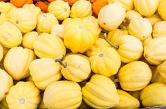 yellow acorn squash at the market - stock photo
