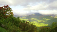 Sunny green mountain - left to right pan Stock Footage