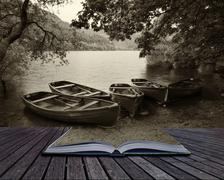 Creative concept pages of book sepia retro style picture of derelict boathous Stock Photos
