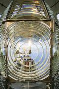 fresnel magnifying lens close up lighthouse glass rotating housing - stock photo