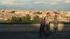 Tourists walk past view of Rome Stock Footage