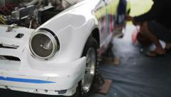 Passionate man repairing car Stock Footage